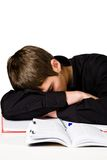 Exhaustion. Photo of a tired student, napping on his notebook Stock Photography