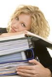 Exhaustion. Blonde woman laying her head on a stack of files stock photography