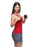 Exhibición de la demostración de la mujer joven del teléfono celular móvil Foto de archivo libre de regalías