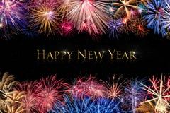 Exhibición de los fuegos artificiales de la Feliz Año Nuevo Foto de archivo libre de regalías
