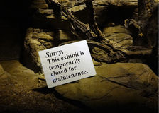 Exhibit Closed Sign. A sign reading, Sorry, this exhibit is temporarily closed for maintenance appears in an indoor zoo exhibit Royalty Free Stock Photography