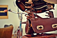 Exhibit of old bicycles. Retro style. Bicycle with genuine leather case for tool Stock Photo