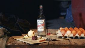 Exhibit of old peasant table with vodka, sausage, onion, eggs and other things. Showing inthe museum stock footage
