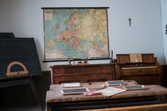 Exhibition area stylized as classroom with map. Budapest, Hungary - July 08, 2015: exhibition area stylized as classroom with map in Hungarian National Museum Stock Image