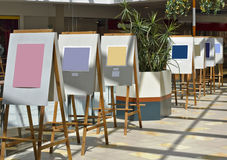 Exhibition of art pictures. Exhibition of art  pictures  in the gallery. Top solar lighting. Contains empty areas patches. Soft art focus Royalty Free Stock Photography
