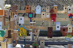 Exhibition of birdhouses made by the schoolchildren together with their parents Royalty Free Stock Photo
