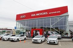 Exhibition car stands in front of the building of KIA MOTORS car selling and service center. Ulyanovsk, Russia - October 06, 2018: Exhibition cars stands in stock photography