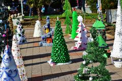 Exhibition of Christmas trees in the town square of Tuapse , made children`s institutions. Pine tree made of alternative material Royalty Free Stock Photos