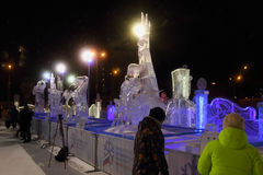 Exhibition of competitive ice sculptures. PERM, RUSSIA - FEB 1, 2017: Exhibition of competitive ice sculptures and people at night, Ice town of Perm in 2017 Stock Photography