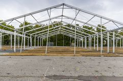 Exhibition construction of a regional fair, tent construction, a. Luminum poles and squared timber for tent floor in the fair tents, view over the exhibition stock photos