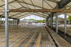 Exhibition construction of a regional fair, tent construction, a. Luminum poles and squared timber for tent floor in the fair tents, view over the exhibition royalty free stock photo