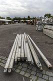 Exhibition construction of a regional fair, tent construction, a. Luminum poles and aluminum profiles for tent poles, in the background tents in construction and royalty free stock image