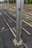 Exhibition construction of a regional fair, tent construction, a. Luminum poles and squared timber for tent floor in the fair tents, view over the exhibition royalty free stock photography