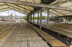 Exhibition construction of a regional fair, tent construction, a. Luminum poles and squared timber for tent floor in the fair tents, view over the exhibition stock photo