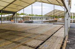 Exhibition construction of a regional fair, tent construction, a. Luminum poles and squared timber for tent floor in the fair tents, view over the exhibition royalty free stock image