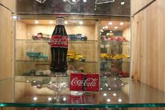 Exhibition dedicated to Coca Cola. A beautiful red Coca Cola bottle royalty free stock photography