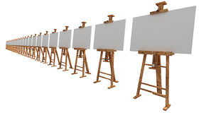 Exhibition of easels with blank canvas. Isolated on white 3d render Stock Photography