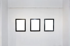 Exhibition gallery interior with empty frames on wall Stock Photos