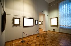 Gallery Interior with empty frame on wall. Stock Photography