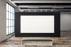 Exhibition hall with empty billboard. Modern exhibition hall with empty billboard and bench. Window with city view. Gallery, art, exhibit and museum concept Stock Photos