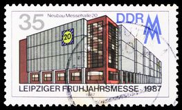 Exhibition Hall 20, Leipzig Spring Fair serie, circa 1987. MOSCOW, RUSSIA - MARCH 30, 2019: A stamp printed in Germany, Demoscratic Republic shows Exhibition stock photography