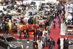 Exhibition hall - Retro Classics. People buy cars - exhibition hall - Retro Classics Royalty Free Stock Image