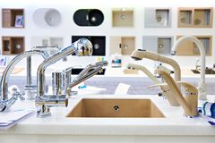 Exhibition of kitchen sinks and taps in store royalty free stock image