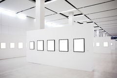 Exhibition with many empty frames on white walls Stock Image