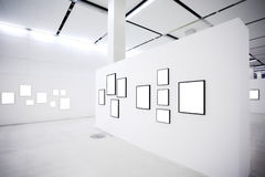 Exhibition with many empty frames on white walls Stock Photos