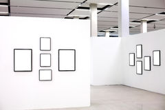 Exhibition with many empty frames on white walls Royalty Free Stock Image