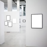 Exhibition with many empty frames on white walls royalty free stock images