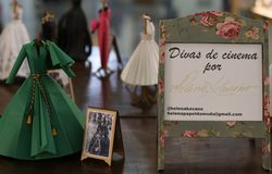 Exhibition of miniature dresses made of paper by Brazilian artist Helena Kavano - Sao Paulo - June 2019. Handmade replicas of famous dresses from Hollywood royalty free stock images