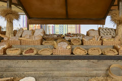 Exhibition of mockup of bakery food on Decumano , EXPO 2015 Mila. MILAN, ITALY - October 07, EXPO 2015, exhibition of samples of bakery  food in a wooden stall Royalty Free Stock Image
