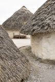 Exhibition neolithic house at Stonehenge, Salisbury, Wiltshire, England with hazel thatched roof and straw hay daubed walls. Sample display house using Stock Photos
