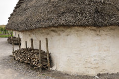Exhibition neolithic house at Stonehenge, Salisbury, Wiltshire, England with hazel thatched roof and straw hay daubed walls Stock Image