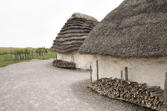 Exhibition neolithic house at Stonehenge, Salisbury, Wiltshire, England with hazel thatched roof and straw hay daubed walls. Sample display house using Royalty Free Stock Photos