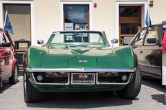 Exhibition of old cars. Interior of an old car. Old design in cars. Beautiful green old Corvette Convertible, front view. Oswiecim royalty free stock photo