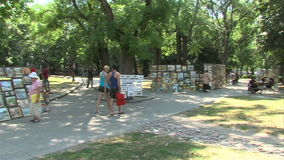 Exhibition of paintings by street artists in the center of Varna, Bulgaria stock video footage