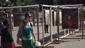 Exhibition of paintings in the street. Dnepropetrovsk SEPTEMBER 11, 2016: Exhibition of paintings in the street on City Day in Dnepropetrovsk, September 11, 2016 stock video footage