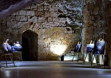 Exhibition of paintings in the underground castle of the Crusaders royalty free stock images