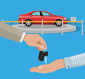 Exhibition Pavilion, dealership with yellow car. Hand gives car keys to another hand. buy, rental or lease a car. Exhibition Pavilion, showroom or dealership Royalty Free Stock Photography
