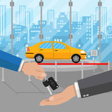 Exhibition Pavilion, dealership with yellow car. Hand gives car keys to another hand. buy, rental or lease a car. Exhibition Pavilion, showroom or dealership Royalty Free Stock Image