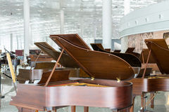 Exhibition of Pianos. Pianos are displayed in the exhibition hall Royalty Free Stock Photos