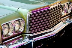 Exhibition of retro cars. Fragment of the front part of the car. With round headlights and grille royalty free stock image