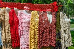 Exhibition and sale of crocheted women's clothing Stock Photos
