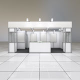 Exhibition stand with blank frieze. Modern simple design exhibition stand with blank white frieze and reception counter Royalty Free Stock Photography