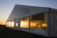 Exhibition tent. Seen during sunrise Stock Photos
