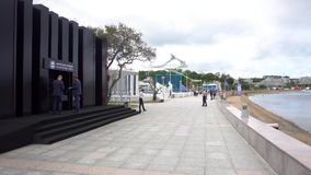 Exhibition walls of the Far East regions on the embankment of the campus of the Far Eastern Federal University. September, 2018 - Vladivostok, Russia - The stock video footage