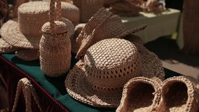 Exhibition of wicker products on street. wicker hats, baskets, handbags