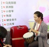 Exhibitor drummer beat the hand drum. China international musical instruments exhibition held in november 2016 11-13 at the xiamen international convention and Royalty Free Stock Images